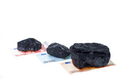 Coal nuggets and banknote Stock Photos