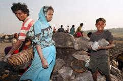 Coal pickers, India. People pick pieces of black coal near the coal mines Royalty Free Stock Images