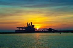 Coal pier at sunrise Royalty Free Stock Image