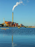 Coal plant on the ocean shore Stock Photography
