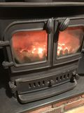Coal pot belly stove. Close up of ember glowing inside coal burning pot belly iron stove stock photo