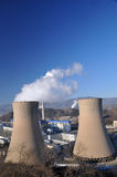 Coal power plant. Polluting the planet, several thin and several thick chimneys smoking towards the sky Royalty Free Stock Image