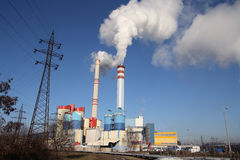 Coal power plant. Polluting the planet, several thin and several thick chimneys smoking towards the sky Stock Images