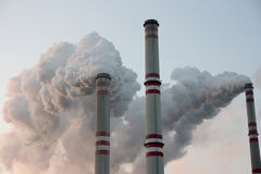 Coal Power Plant Chimneys Stock Photos