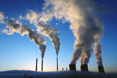 Coal power plant during a foggy morning Royalty Free Stock Images