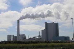 Coal power plant on the maasvlakte in Rotterdam the Netherlands with steam coming out stock image