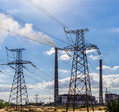 Coal power plant pollution and power lines. Coal power plant pollution and power lines Royalty Free Stock Photo