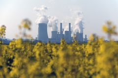 Coal power plant and rapeseed field Stock Photography