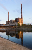Coal power plant with reflection at dusk, industrial landscape. Stock Images