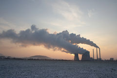 Coal powerplant against sun rise Stock Photos