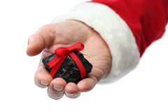 A coal on santa claus hand Royalty Free Stock Photography