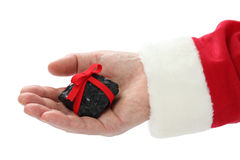 A coal on santa claus hand royalty free stock images