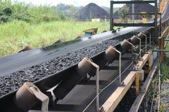 Coal shipped from stockpiles. Black coal shipped from stockpiles to barges royalty free stock photos