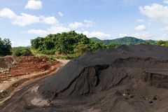 Coal Stock pile and blue sky Royalty Free Stock Photography