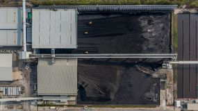Coal storage and bulldozer, Aerial view coal mining industry royalty free stock image