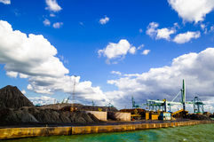 Coal stored in the port of Antwerp. View on Coal hills stored in the port of Antwerp Stock Images