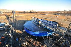 Coal Supply Thickener. A large blue thickener tank where material is slowly stirred with a submerged rake to separate different sized material and the waste Stock Photo