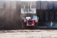 Coal turck. A coal haul truck dumping a load of coal in a hopper in a mine in Wyoming Stock Photo