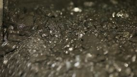 The coal on the vibrating table stock footage