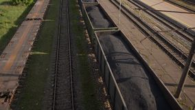 Coal wagons on railway tracks slowmo stock footage