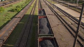 Coal wagons on railway tracks slowmo stock video footage