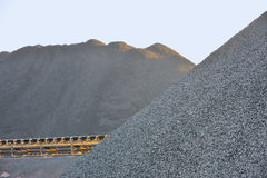 Coal yard in heaps for industrial use Royalty Free Stock Images