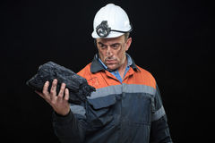 Coalminer holds out a large chunk of energy rich Royalty Free Stock Photography
