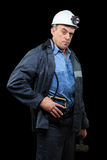 Coalminer holds out a large chunk of energy rich Stock Image