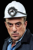 Coalminer holds out a large chunk of energy rich Royalty Free Stock Photos