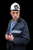 Coalminer holds out a large chunk of energy rich Royalty Free Stock Images