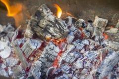 Coals burn in the fire. Roast fire flames. hot coals. ash on the coals in the fire stock photo