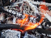Coals of a burning campfire. Close up royalty free stock photography