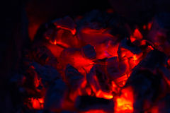Coals of campfire in the forest closeup Stock Photo