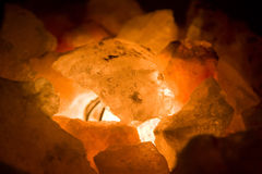 Coals in fire. Coloured stones coals in the light close up Royalty Free Stock Photos
