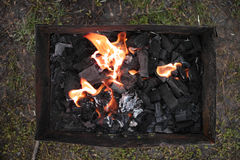 Coals in the grill Royalty Free Stock Images