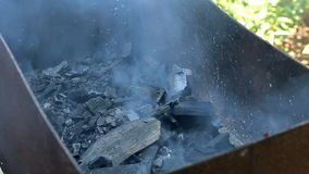 The coals in the grill for cooking meat stock footage