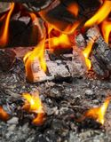 Coals in the fire. Coals in a hot fire close up stock photos