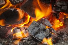 Coals in the fire. Coals in a hot fire close up royalty free stock photo