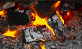 Coals in the fire. Coals in a hot fire close up royalty free stock images