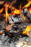 Coals in the fire. Coals in a hot fire close up stock photography