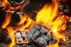 Coals in the fire. Coals in a hot fire close up royalty free stock photography