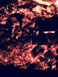 Coals. Hot fire coals on a cold night Royalty Free Stock Photography