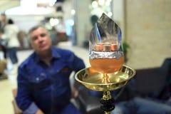 Coals on the orange bowl of nargile Stock Photography