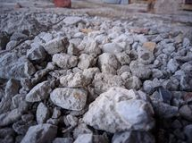 Coarse aggregates covered with cement and dust. Coarse aggregates covered cement dust royalty free stock photography
