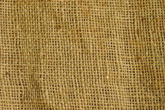 Coarse burlap fabric. Closeup of coarse tan colored burlap fabric stock photo
