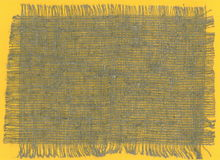 Coarse Burlap Fabric Torn Edges on yellow background Royalty Free Stock Images
