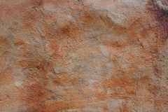 Coarse cement surface with orange stains texture. Coarse cement surface with orange stains with copy space royalty free stock photography