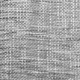 Coarse fabric background. Close up of coarse fabric woven from different colored threads black and white light Royalty Free Stock Photography