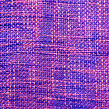 Coarse fabric background. Close up of coarse fabric woven from different colored threads in purple tonality Royalty Free Stock Images