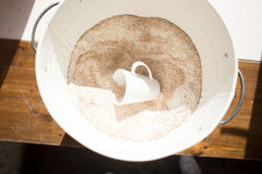 Coarse flour in a bucket Stock Photography
